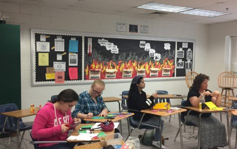 American Sign Language Club members [left to right] Ana Martinez-Xacur, Josephine Bradley, and Karines Velasquez, as well as club sponsor Jenny Bradley, create Christmas cards to send to a local homeless shelter at their meeting on November 30.