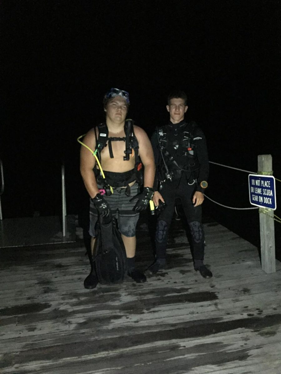 Yari+%28left%29+and+Grant+Manock+%28right%29+after+getting+out+of+the+water+on+a+night+scuba+dive.