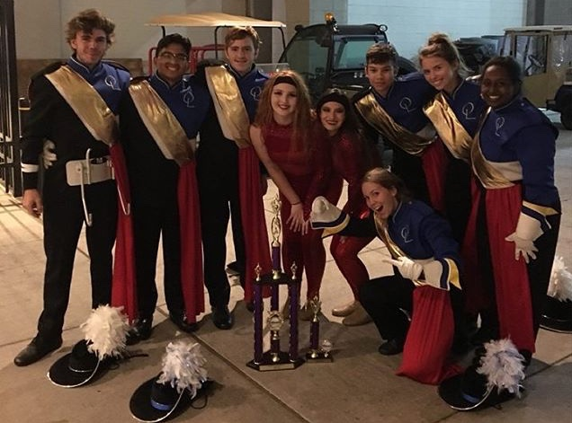 Band+and+guard+members+%28left+to+right%29+Ryan+Boylan%2C+Romeo+Manoza%2C+Hunter+Cigich%2C+Paige+Zuchristian%2C+Kaley+Cotner%2C+Brianna+Calkins%2C+Charles+Via%2C+Sibley+Brown%2C+and+Reehan+Siraj+pose+after+their+successful+performance.