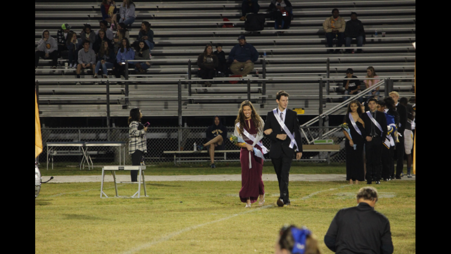 Photo+by%3A+Kelly+Singer.+%0AChloe+Bishop+and+Micah+Singer+represented+the+junior+class+during+the+Homecoming+presentation.+