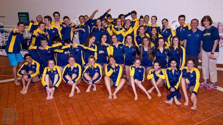 The+2015-2016+Dolphin+swim+team+poses+for+a+picture+after+a+swim+meet.+