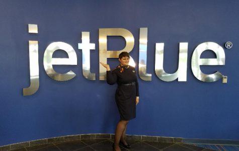 Alumnus Katrina Miller touches the sky as a flight attendant