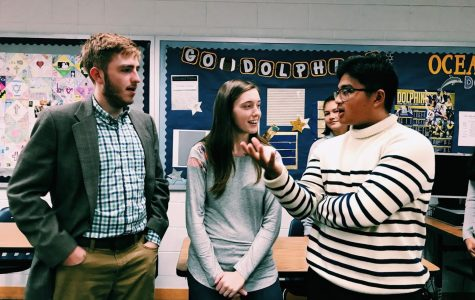 Hunter Cigich, Lauren Chuderewicz, and Romeo Manoza discuss different Forensics categories.