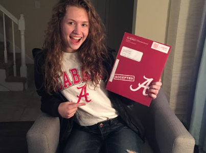 Cynthia shows off her acceptance letter and school pride
