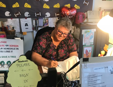 Both security and assistant staff member Cheryl Lint organizes and prepares administrative tasks in the Guidance Office.