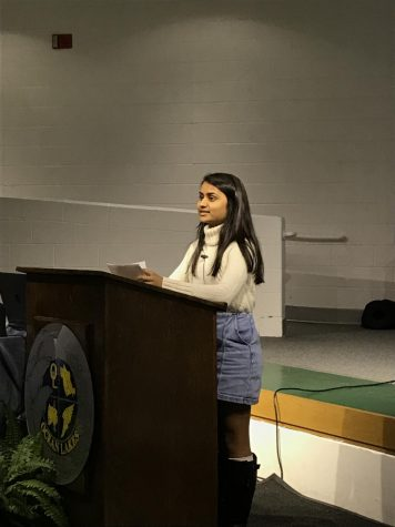 Senior Rutvi Patel presents her capstone project on oncology in the schola on March 23.