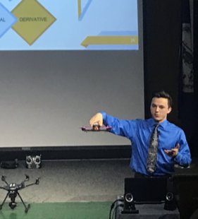 Senior Chet Wiltshire demonstrates how drones fly in his magnet presentation on Tues., March 6.