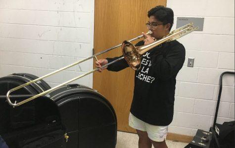 Romeo plays his trombone in the band storage closet.