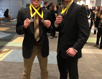 Seniors CJ Reed and Chris Levine pose with their medals at the Virginia Beach Convention Center.