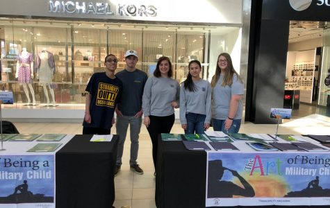 S2S members sophomore Angelo Shaw, senior Harrison Sawyer, senior Mickinley Plyman, junior Shirlen Chen, and junior Chyanne Weber stand by a table at Lynnhaven Mall.