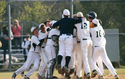 The baseball team jumps together in celebration of their win against First Colonial on April 17.