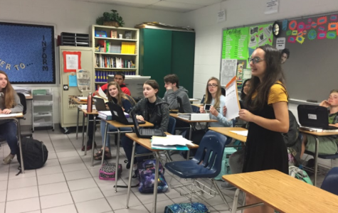 Photo of Britanie Rivera advertising ticket sales during English class. Photo by Fara Wiles.