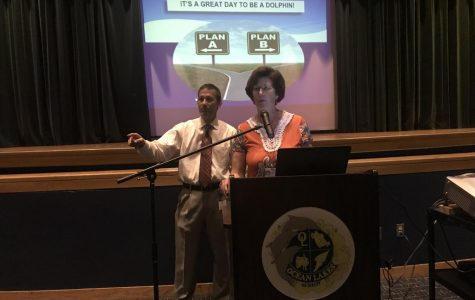 Assistant Principal James Imbriale (left) and Principal Claire Leblanc (right) welcome the senior class.
