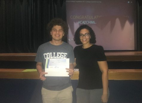 Max Lichtenstein accepts scholarship from Amy Hall in the school auditorium on Monday, Sept. 24.