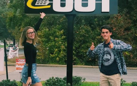 Rachel Vincent and Stephen Kelley pose in front of the Cook Out sign on November 2.