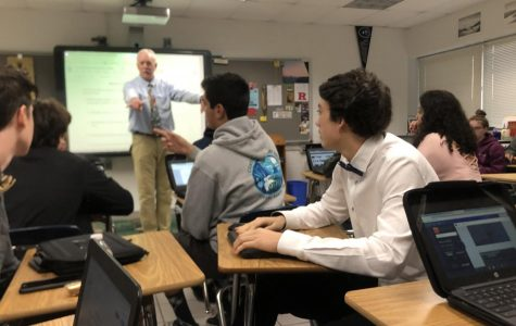Students engaged in active listening during English 12 teacher John Kelly's 1A Honors class on Dec. 18.