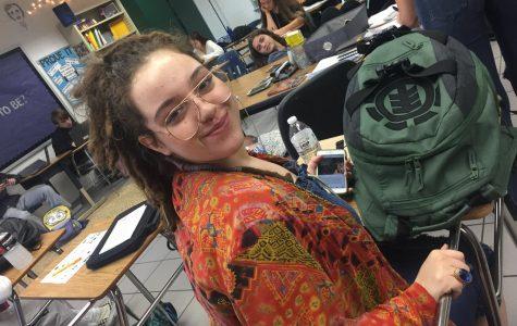 Senior Hannah Petty smiles for her study block teacher on Jan. 11.