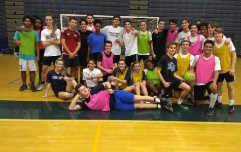 Boys and girls soccer teams practice together in the gym on Jan. 4 to improve skills for season.
