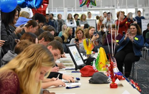 Twenty one student athletes sign and commit to 21 universities, colleges during the ceremony.