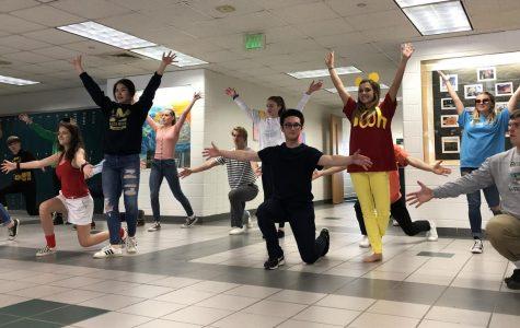 Mr. OL contestants and escorts rehearse the contestant-escort dance on March 12, 2019.