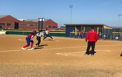 Junior Emily Demartino pitches against Kempsville Chiefs at home on March 19.