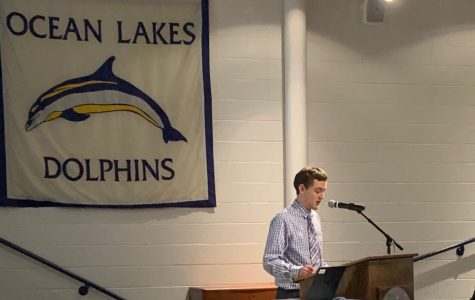 Ethan Boardman giving senior presentation to students in Ocean Lakes Schola.