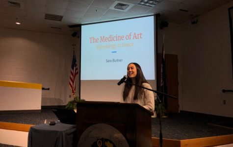 Senior Sara Burtner introduces her senior capstone project in the Schola on March 19, 2019.