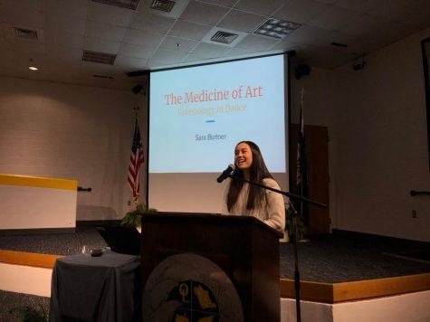 Senior Sara Burtner introduces her senior capstone project in the Schola on March 19, 2019.