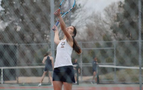 Girls tennis holds off Granby at home match