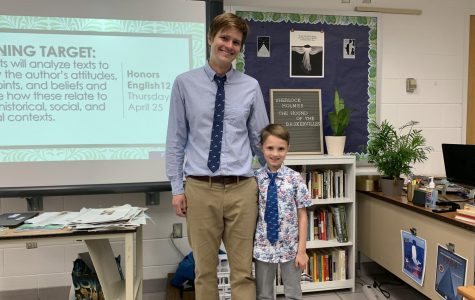 English teacher Christopher Robinson introduces his son Elliot to his students.