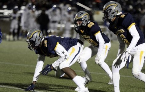 Naquan Brown (number ten), Tyler Verner (number 89), and Devon Allen (number six) get ready for the next play at the Virginia Beach Sportsplex.  Photo taken by: Recruit 757