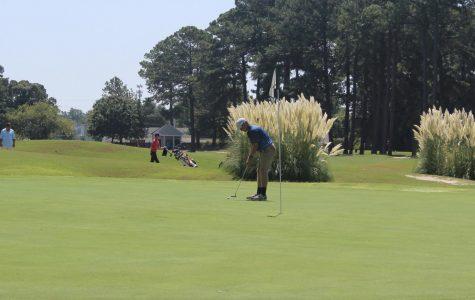 Golf team wins opening tournament