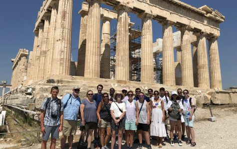 Students and teachers stand in front of the Parthenon in Athens, Greece.