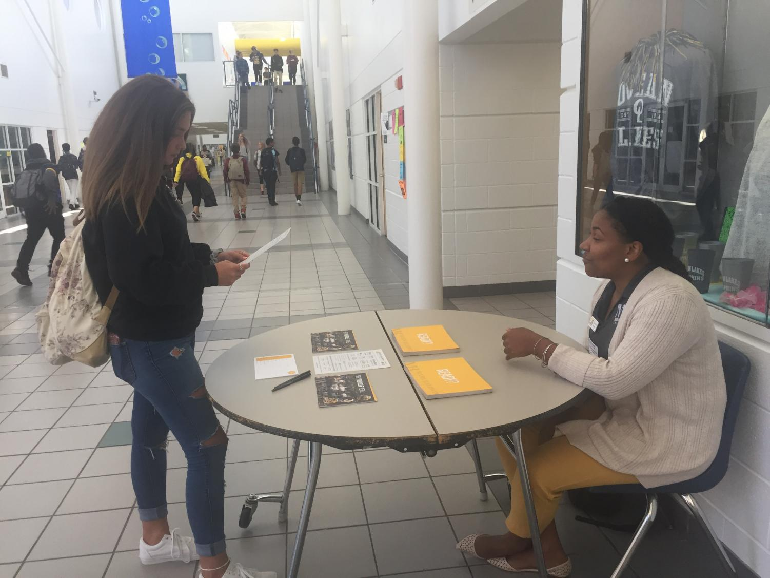Senior Breanna Acosta talks to MBU admissions counselor Brittany Roberts about the programs available through the college.