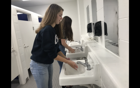 Seniors Julia Mitchell and Kerri Hewett practice good hygiene by washing hands before lunch on Sept. 20.