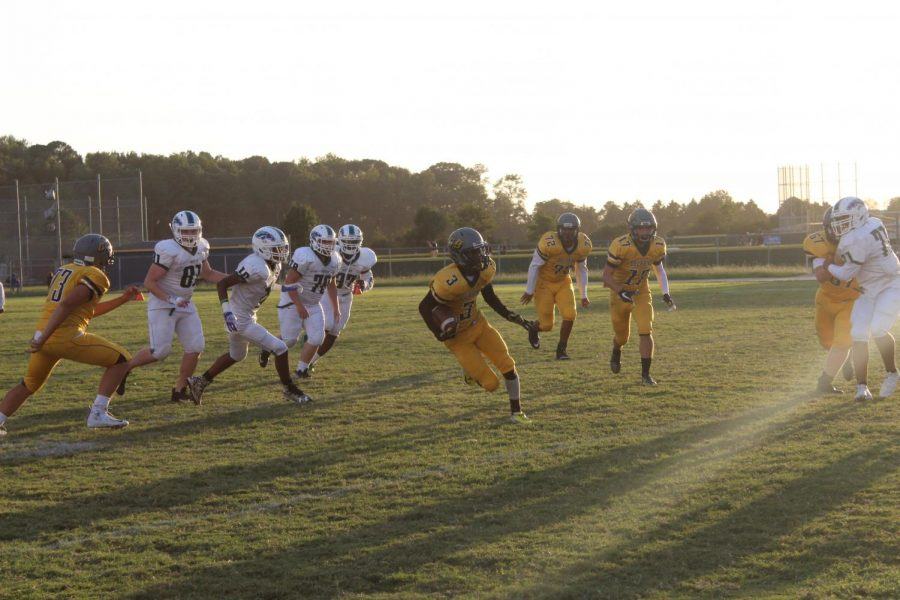 Sophomore+wide+receiver+Caleb+Johnson+evades+defenders+in+a+JV+football+game+at+Ocean+Lakes+on+Sept.+19.