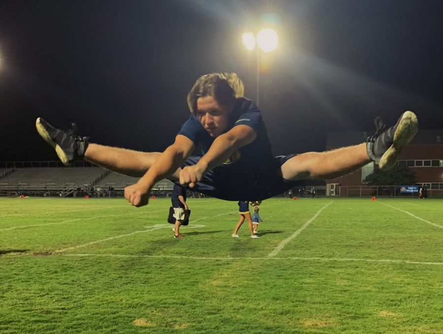 First male sideline cheerleader jumps into season