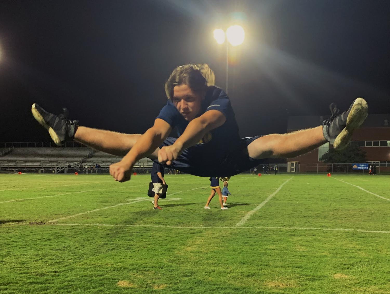 Sophomore Isaiah Alspaugh jumps to celebrate after Ocean Lakes victory against Landstown on Sept.  13, 2019.