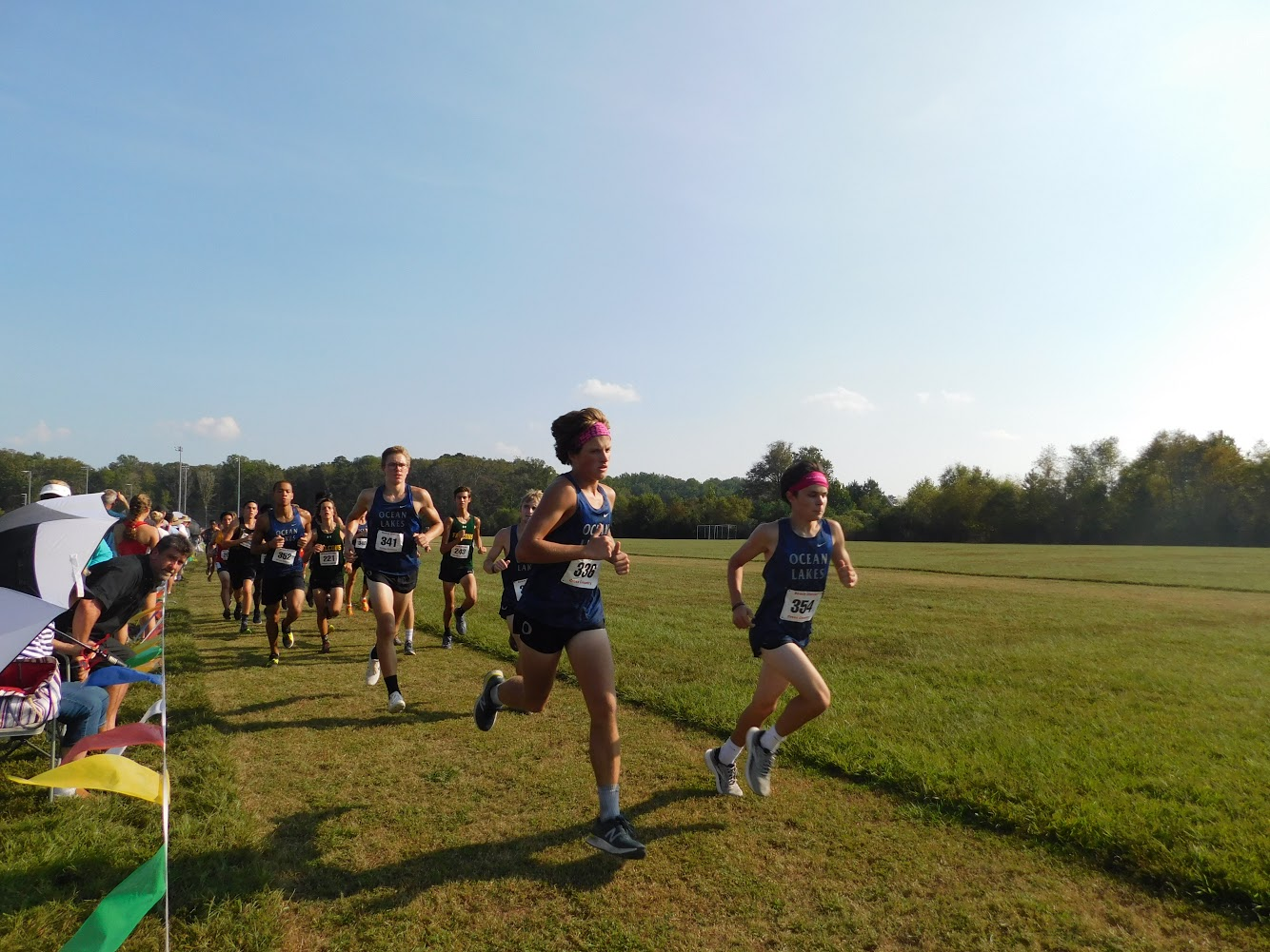 Ocean Lakes boys start race in a pack at  beach district meet three.