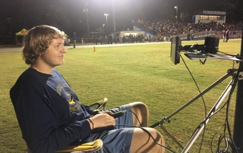Junior's love for photography benefits football team