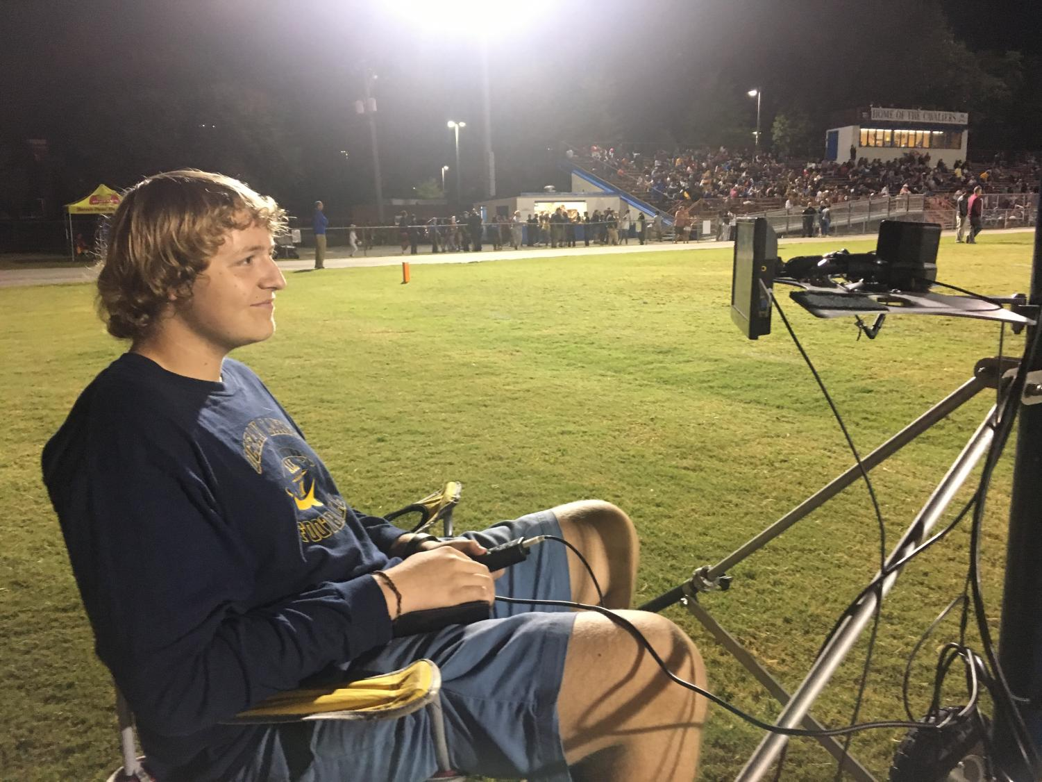 Jackson Ploeger takes pictures in the end zone at the Princess Anne game on Sept. 20, 2019.