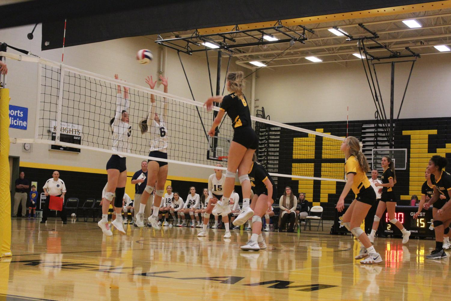 Girls volleyball stretches towards a spike. October 22, 2019.