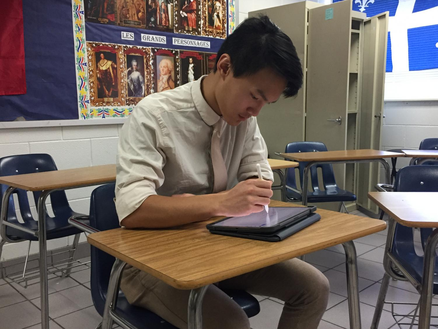 Vi Giang completes his most recent science assignment in room 251. Photograph taken by Alexia Fenner.