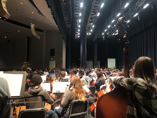 Orchestra members practice for performance with Grammy-nominated musician Jeremy Kittel on Oct. 22.