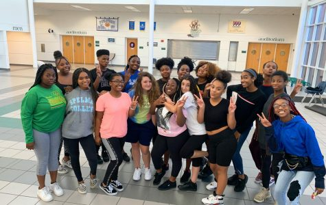 Step team poses for a photograph at practice in the cafeteria foyer on Oct. 23.
