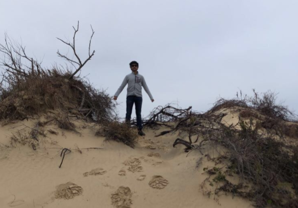 Senior Saighuhan Senthilkumar poses at Jockey's Ridge State Park.