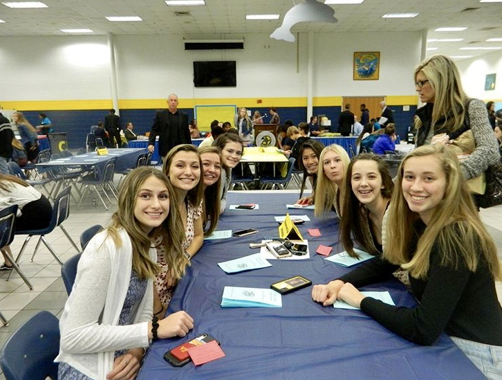 The+Girls+Volleyball+team+sits+together+during+the+banquet+on+November+27.