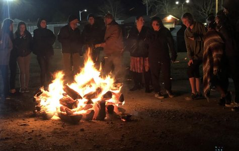 Students and faculty gather around the SCA-sponsored bondfire on Dec. 18.