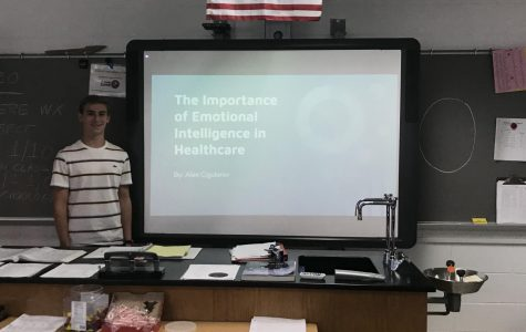 Alex Cigularov presents his senior project to fellow academy kids on December 18, in room 230.