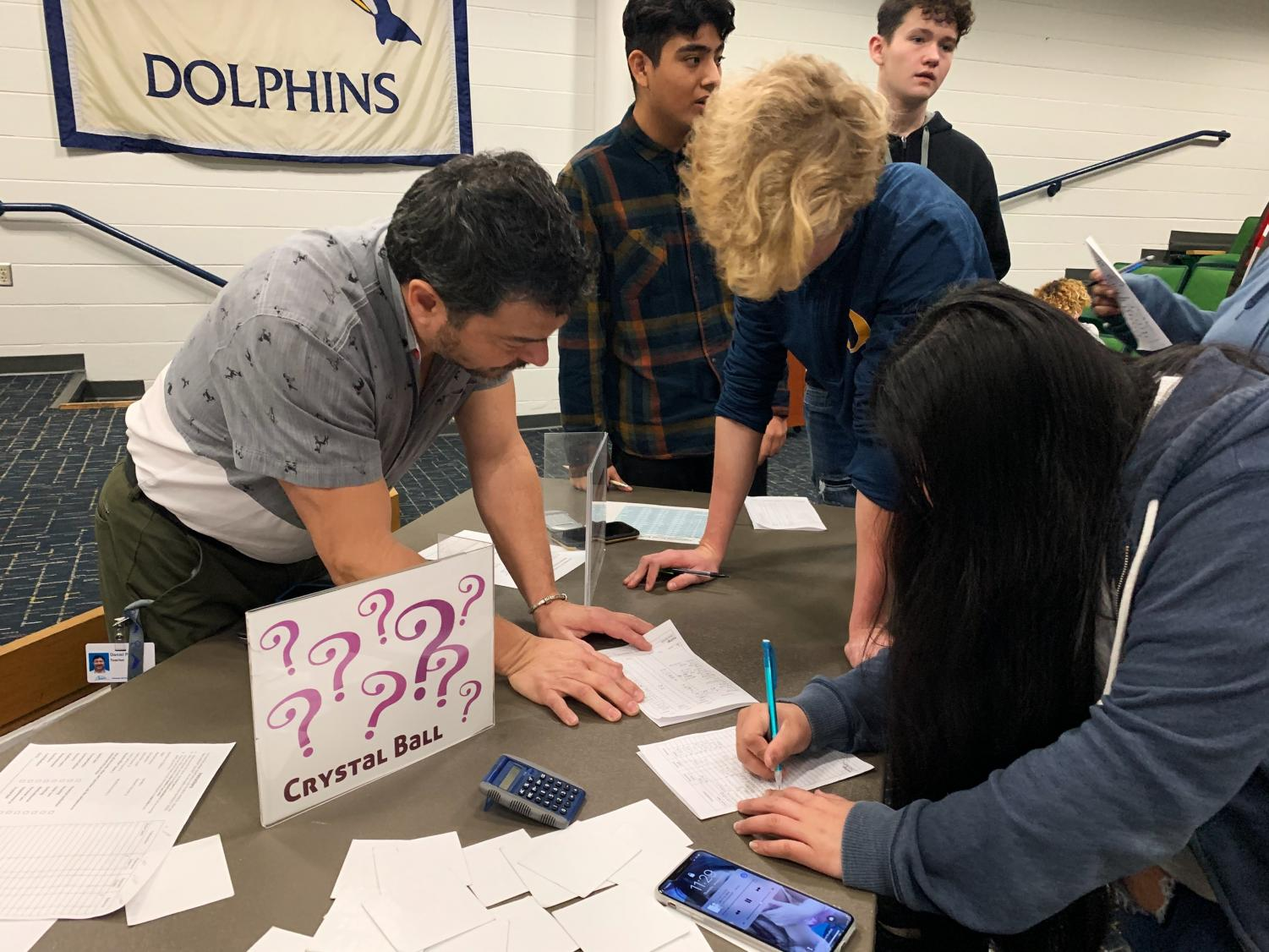 Students fill out their finance chart at one of the stations in the schola on Jan. 23, 2020.